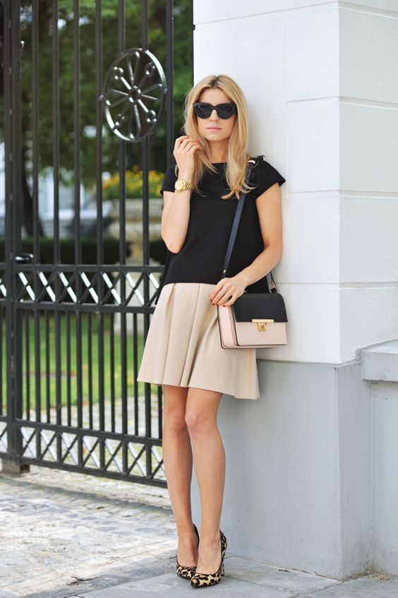 nude skirt, a black tee and leopard print shoes