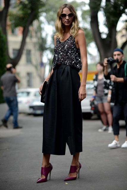 Look with eye catching top and black midi skirt