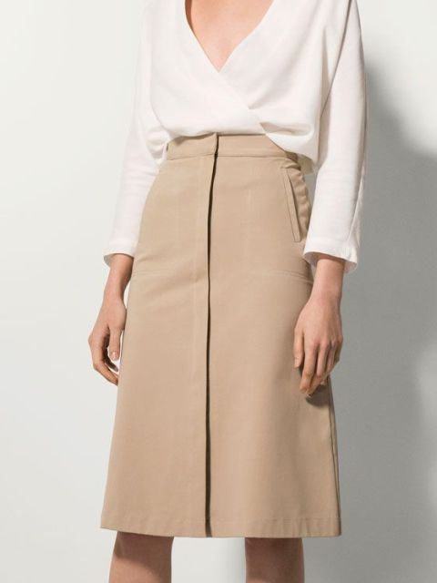 Stylish look with white V-neckline blouse and knee-length skirt