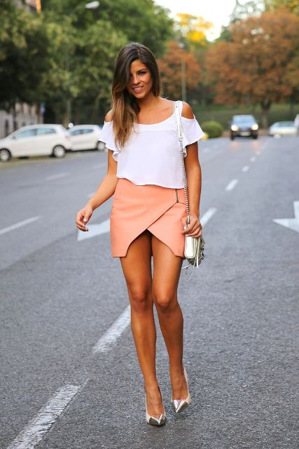 With chic off the shoulder top, pumps and crossbody bag