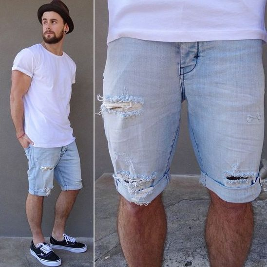 distressed blue denim shorts, a white tee and black sneakers
