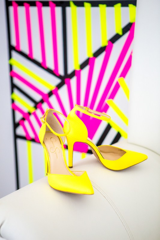 Her neon yellow heels polished her bridal look