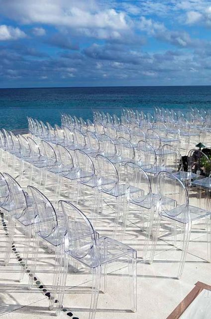 Lucite chairs for beach theme wedding