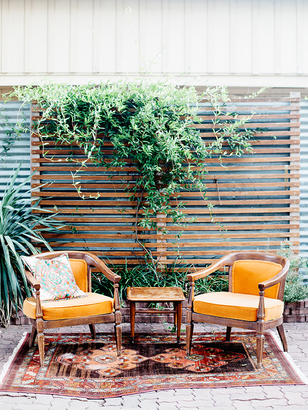 orange wedding lounge areas - photo by Veronica Ellerman Photography http://ruffledblog.com/vibrant-bohemian-wedding-inspiration