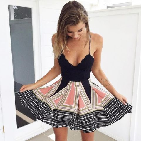 Unique dress with black upper part and printed lower one