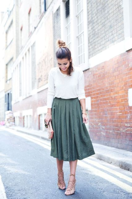 Chic look with white sweatshirt and midi A-line skirt
