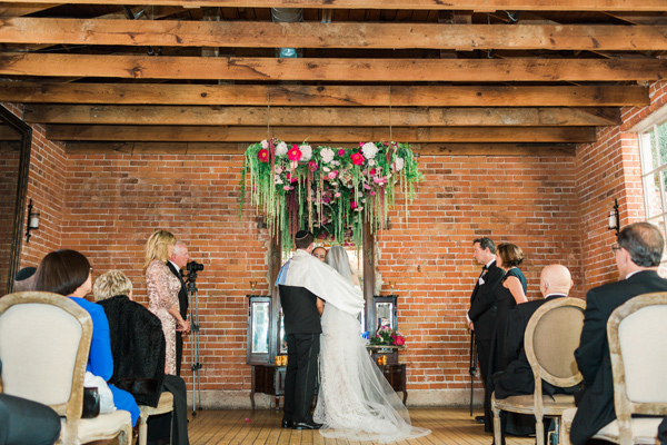 wedding ceremony - photo by Valorie Darling Photography http://ruffledblog.com/floral-filled-carondelet-house-wedding