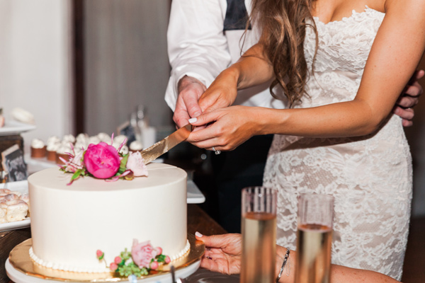 cake cutting - photo by Valorie Darling Photography http://ruffledblog.com/floral-filled-carondelet-house-wedding