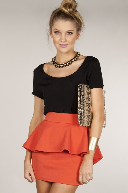 With black shirt and statement necklace