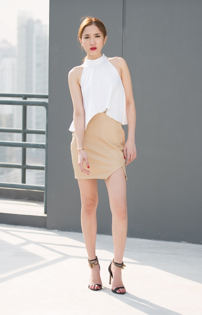 With white halter top and heels