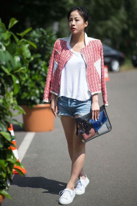 denim shorts, a white tee, a red jacket and white sneakers