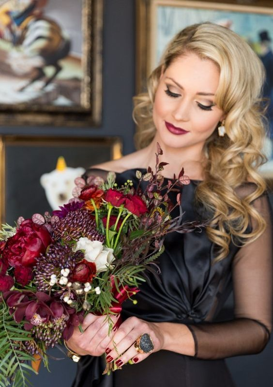 moody colored wedding bouquet with red roses