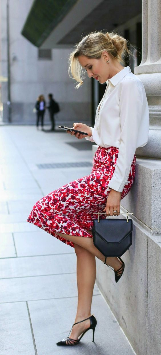 a white blouse, a floral pencil skirt and black heels