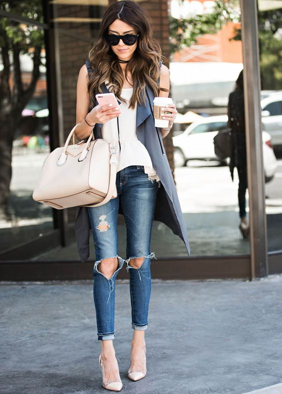 ripped jeans, a white tee and a grey long vest