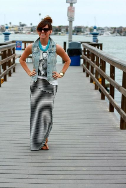 Relaxed look with denim vest, t-shirt and striped maxi skirt