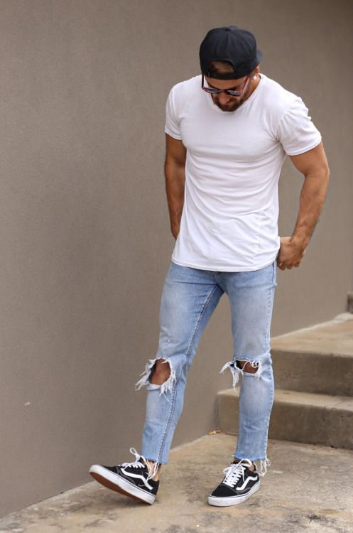 light blue distressed jeans, a white t shirt and black sneakers