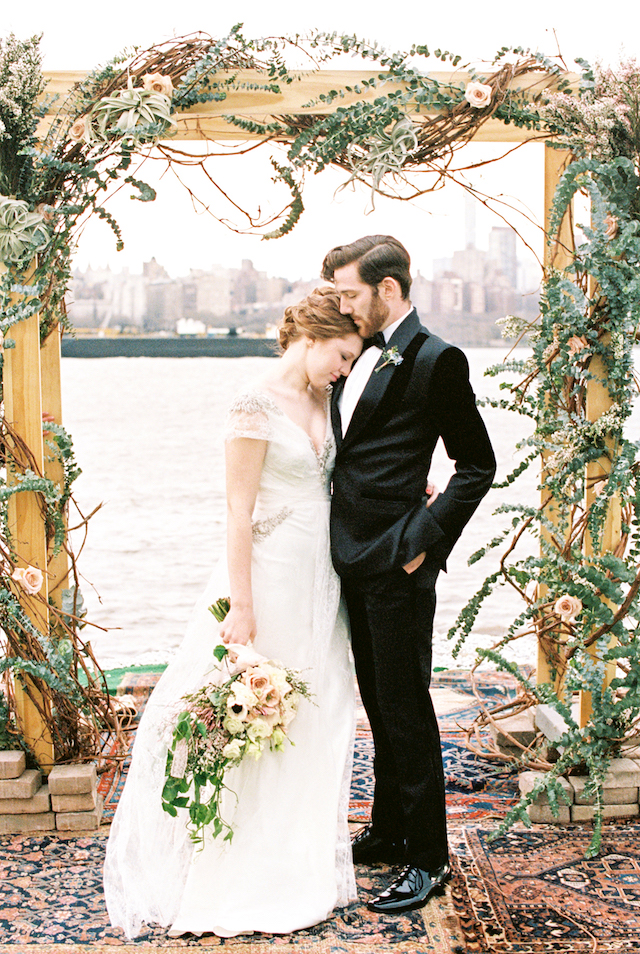 NYC wedding ceremony with skyline and flower adorned arch | Alexis June Weddings