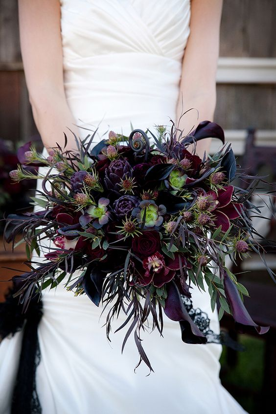 dark red and purple wedding bouquet with succulents