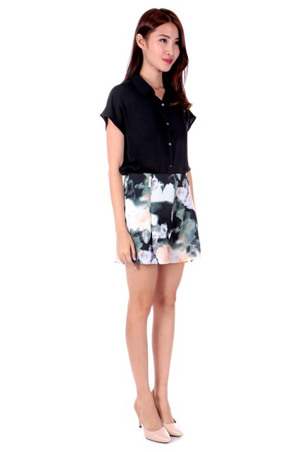 With black shirt and neutral shade pumps