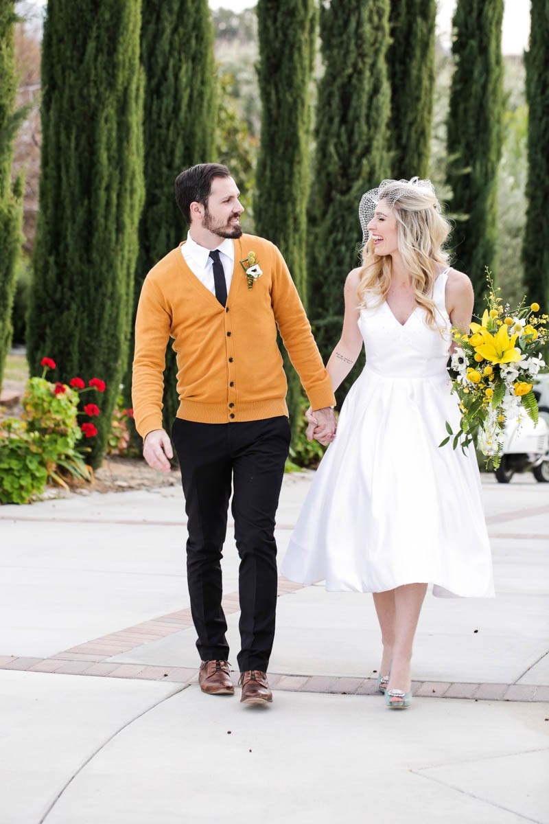 The groom added a yellow cardigan to his look to tie with the wedding colors