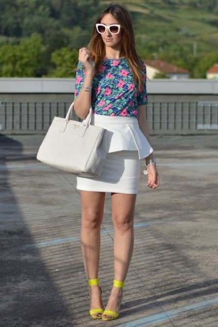 With floral shirt and yellow heels