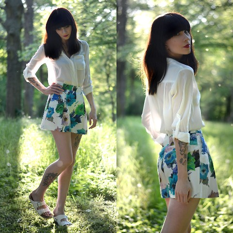 With classic blouse and flat sandals