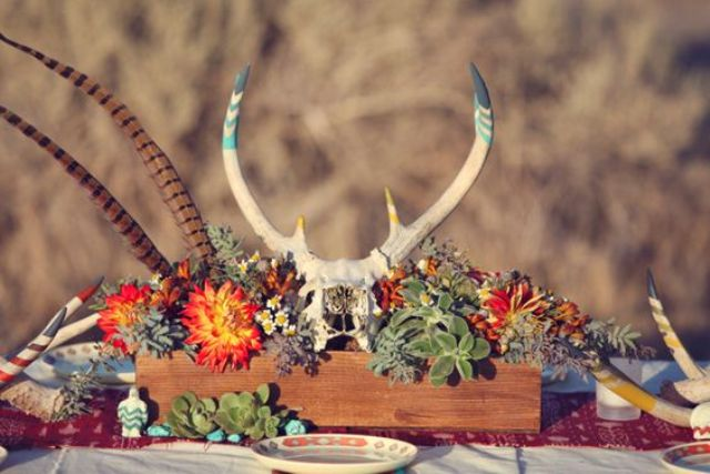 antlers and feather centerpiece for a fall boho wedding