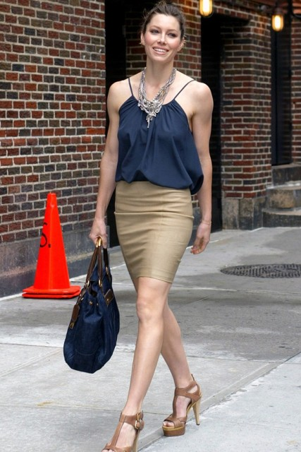 With midnight blue top, neutral heels and big bag