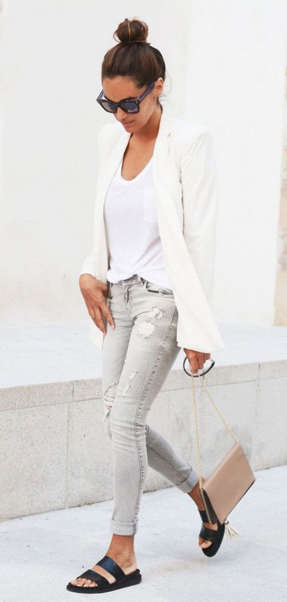 grey jeans, a white top, a white jacket and black slippers work outfit
