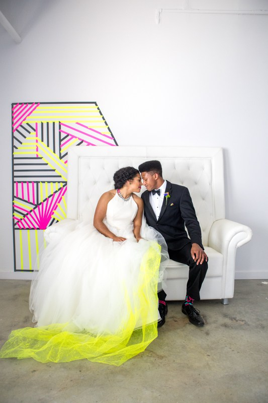 Her white dress was accentuated with neon yellow tulle