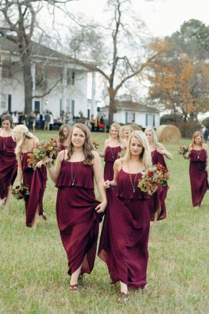Pleated burgundy maxi bridesmaid dresses
