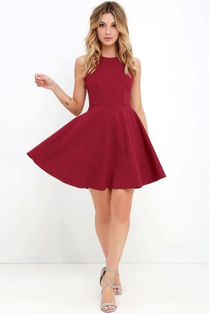 Look with deep red dress and lace up heels