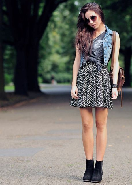 Trendy look with denim vest and printed mini skirt