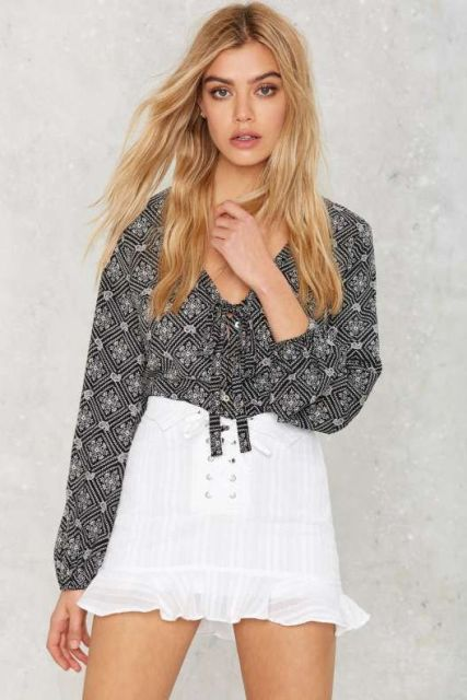 Look with printed blouse and white girlish skirt