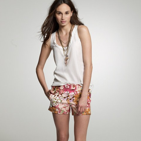 With white tank top and accessories