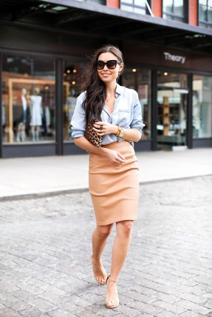 With denim button down shirt and heels