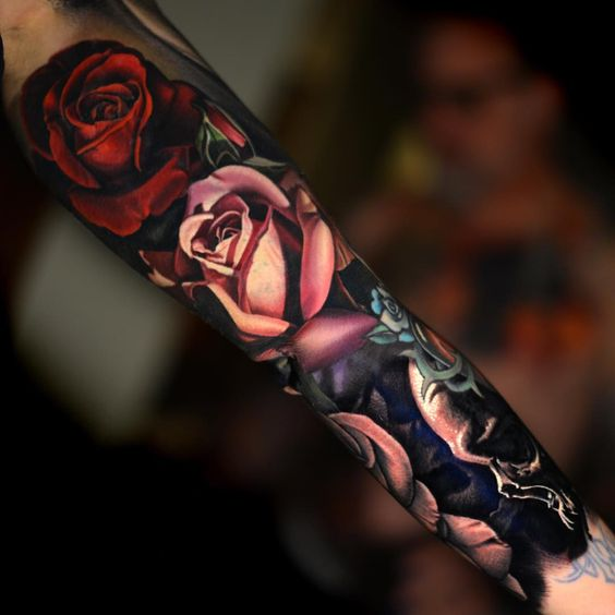 realistic moody floral tattoo sleeve
