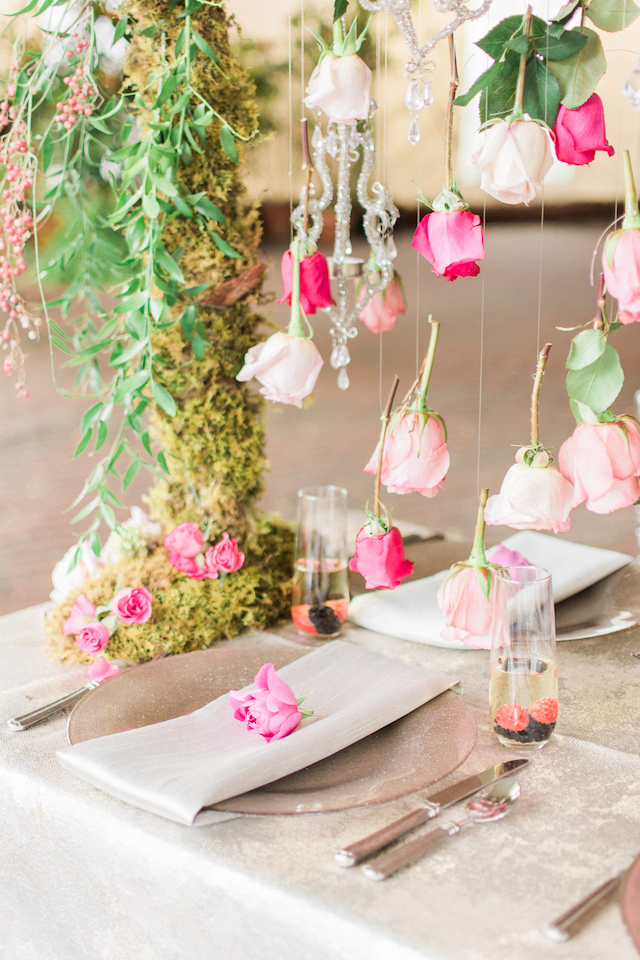 Roses suspended over a wedding reception table   Anna Markley