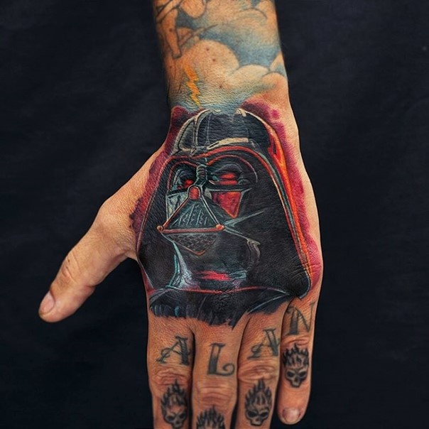 Darth Vader in a mask tattoo on a hand