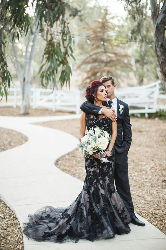 wedding dress with black lace and tulle on it