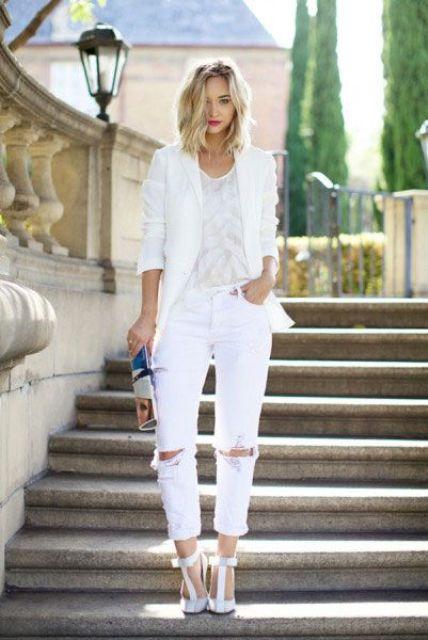 ripped white jeans, a white top, a white jacket and t-strap white heels