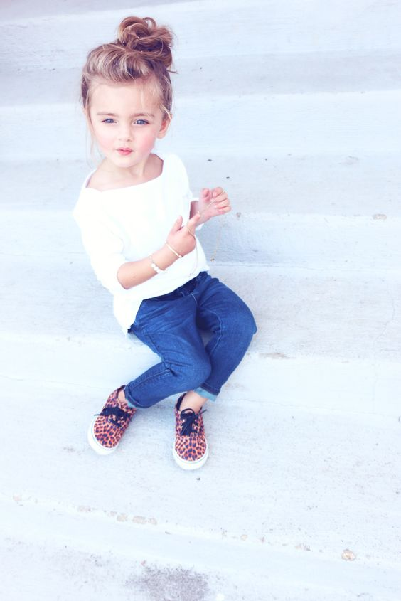 blue jeans, a white tee and leopard print sneakers