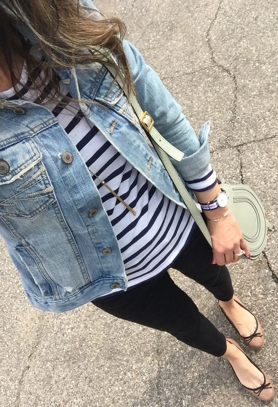 denim jacket, a striped top, black jeans, tan flats