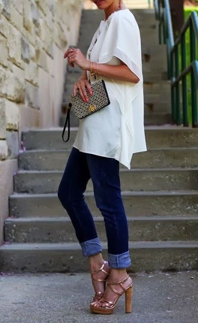 an oversized high-low top, navy jeans and high heels