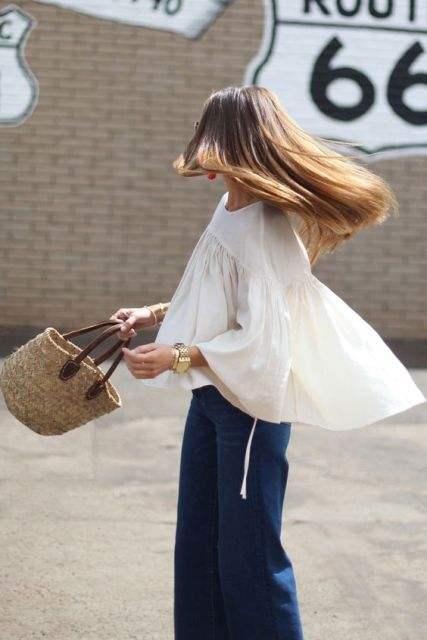 Loose shirt, jeans and medium straw bag