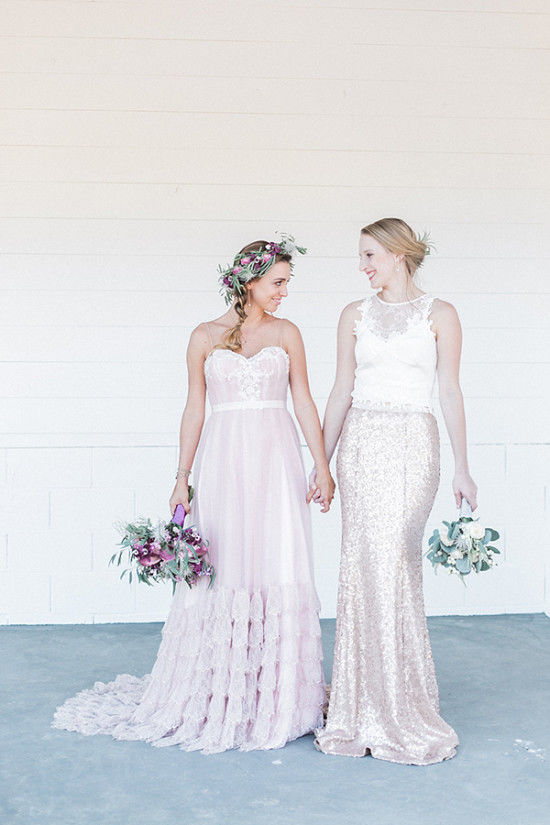 The second bride was wearing an off white lace appliqué crop top with a fit and flare rose gold sequin skirt