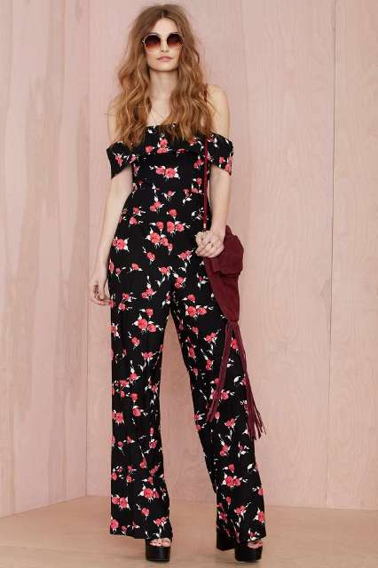 Floral jumpsuit with platform sandals and oversized sunglasses