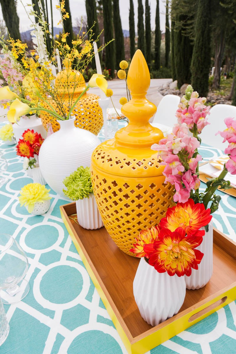 The tablescape catches an eye with color blocked florals