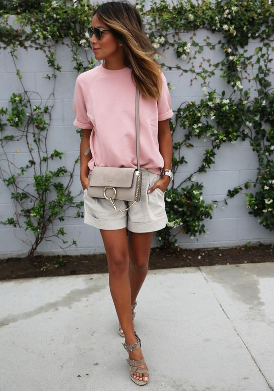 grey shorts, a blush tee and grey sandals