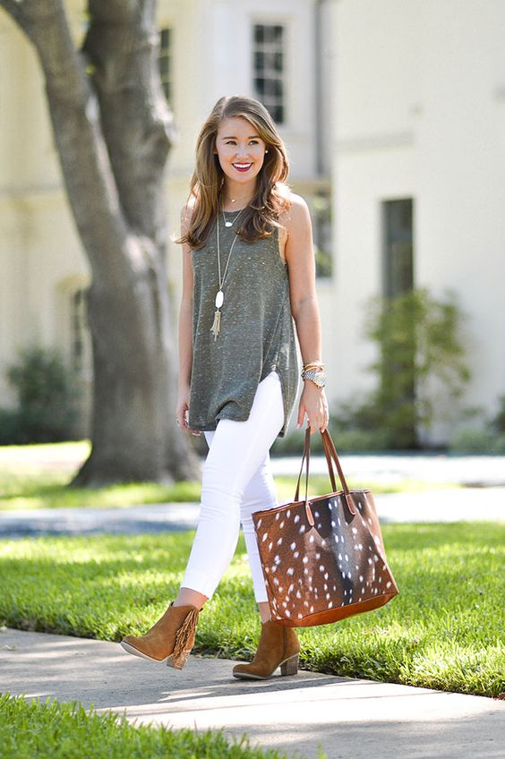 oversized grey top, white jeans and cowboy booties